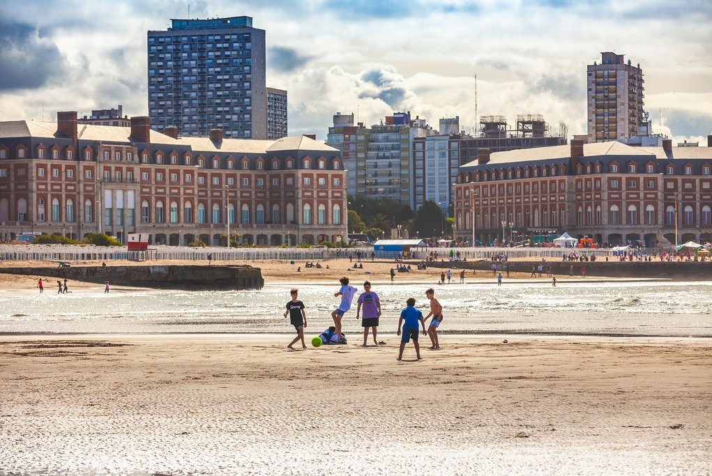 Kids playing soccer on the beach in Mar del Plata, Argentina