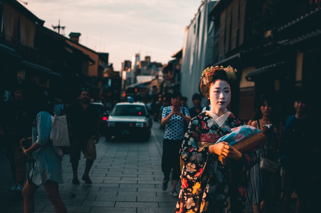 A Maiko Walking the Streets of Kyoto.