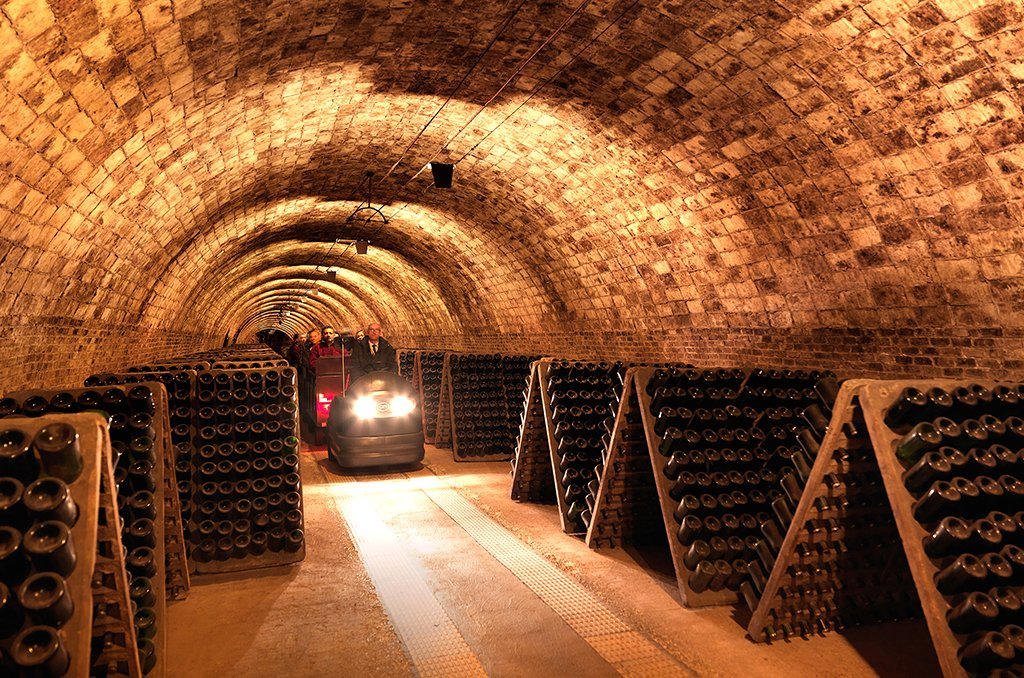 Visit the cava cellar's underground warehouses