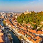 Cityscape of Ljubljana, the Ljubljanica river, and castle