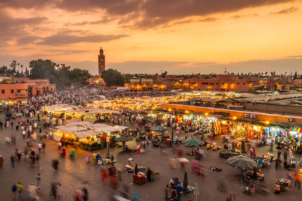 Sunset over Jemaa el-Fna Square and the Koutoubia minaret in the distance