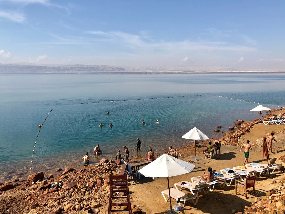 People enjoying the Dead Sea shoreline