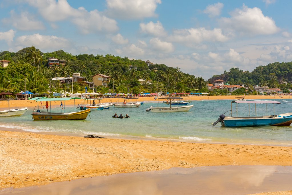 Spend the day relaxing on the sandy beaches of Unawatuna