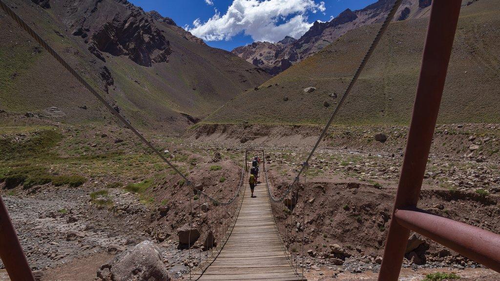 Crossing a suspension bridge in the Aconcagua Provincial Park