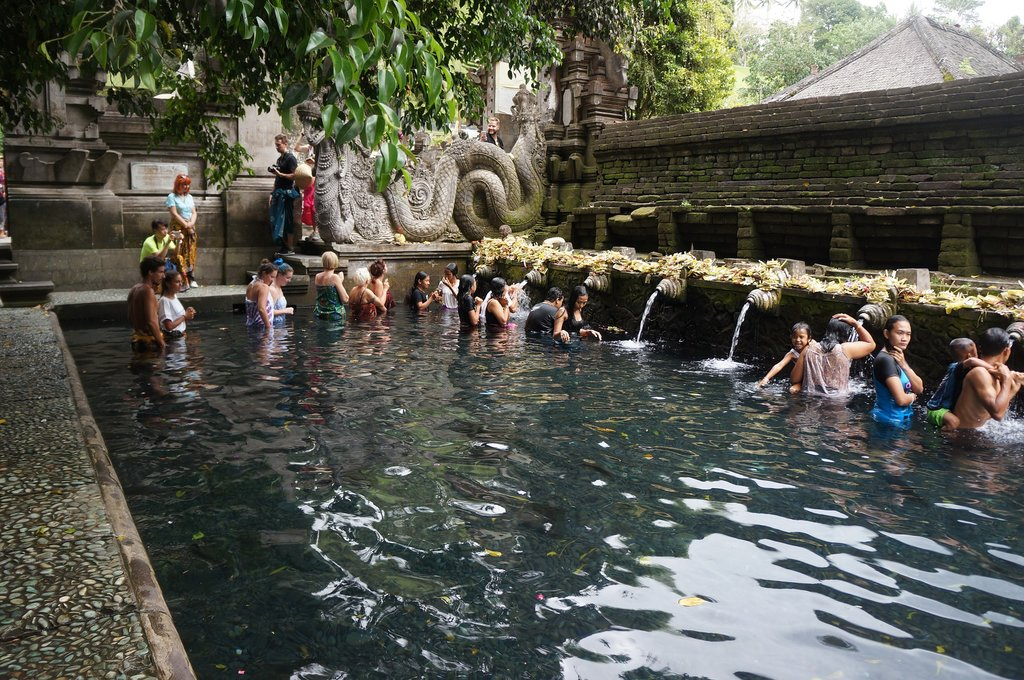 You can bathe in holy water at Tirta Empul Temple