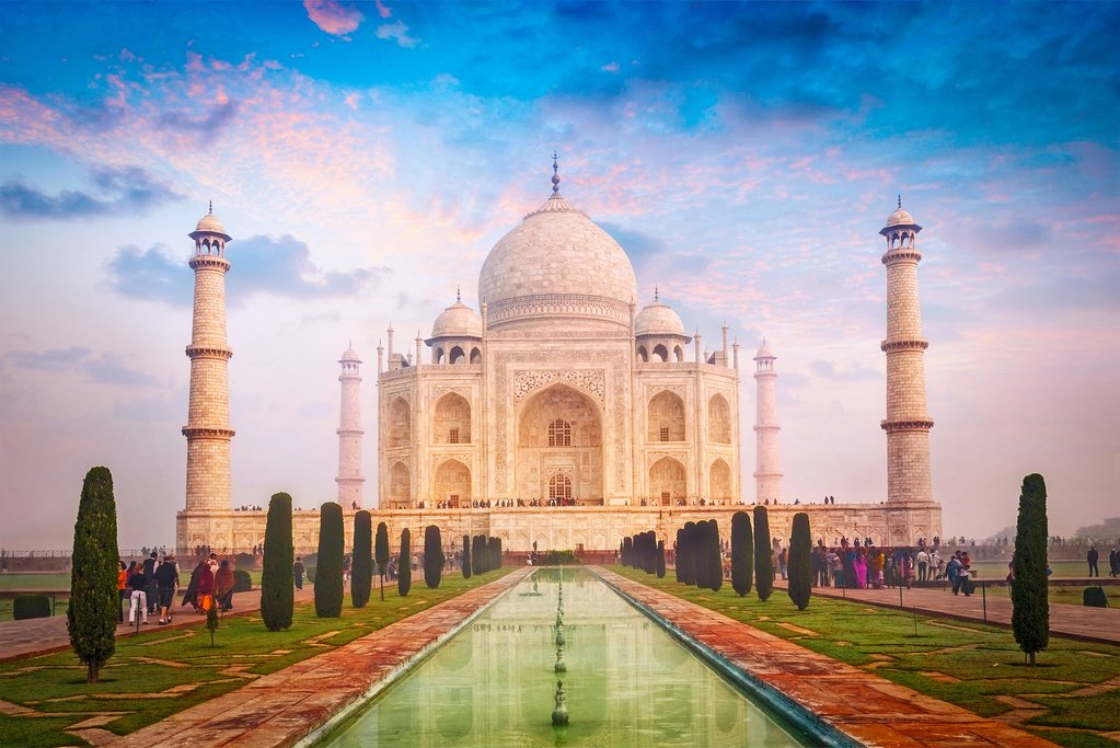 Visit the Taj Mahal at sunrise
