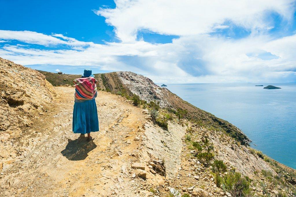 A woman walking on Isla del Sol on Lake Titicaca