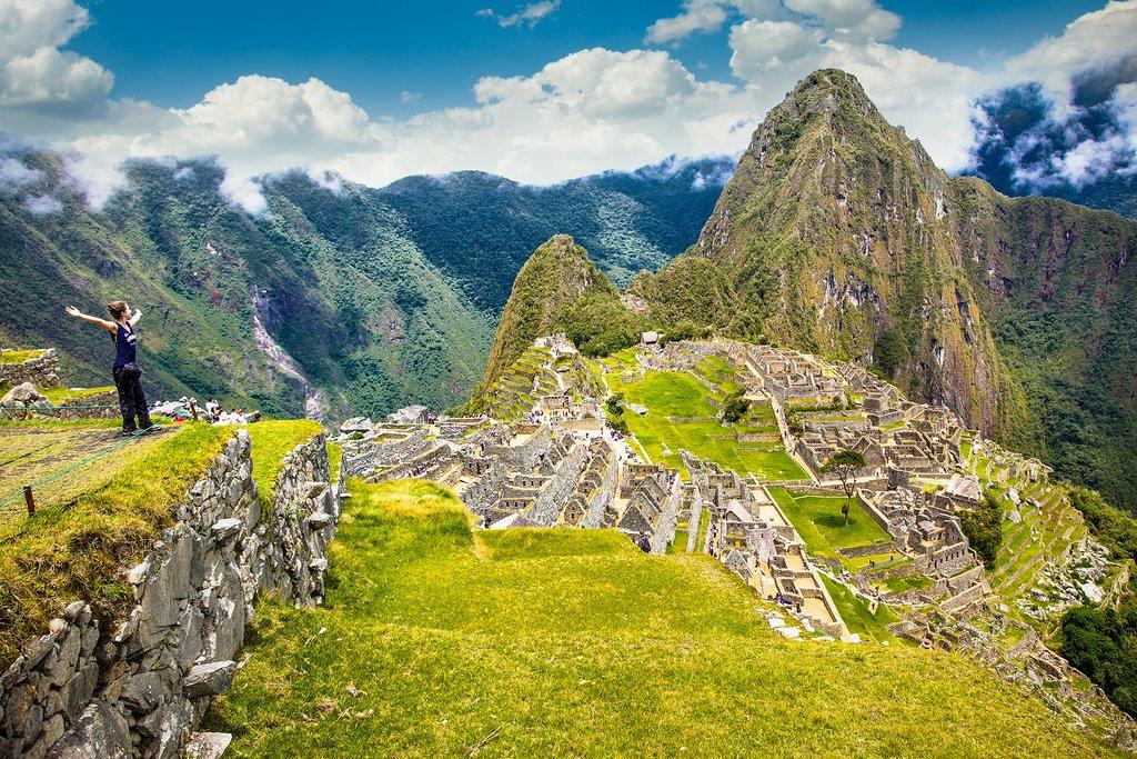 Explore Machu Picchu at sunrise.