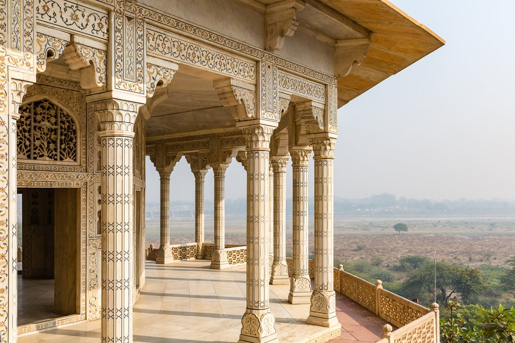 Visit Agra Fort at sunset for your first glimpse of the Taj Mahal!