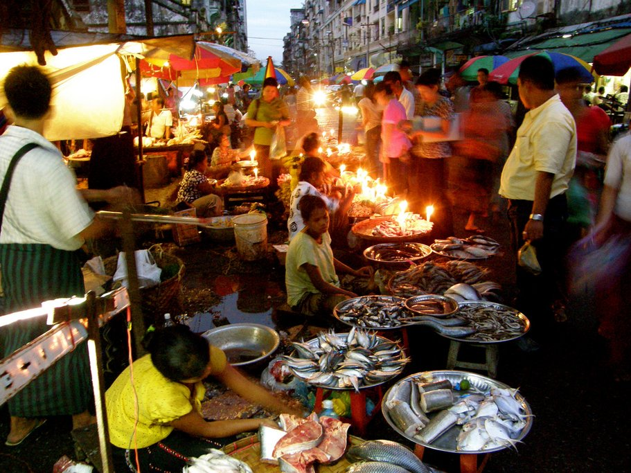 A lively outdoor market in Yangon
