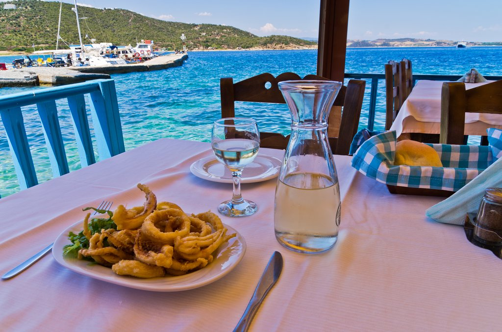 Calamari and white wine at a taverna on Ammouliani Island