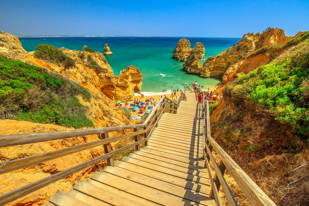 Take the wooden walkway to scenic Praia do Camilo in Lagos