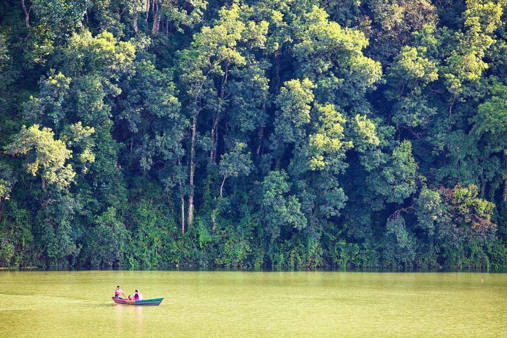A small wooden boat on tour around Phewa Lake