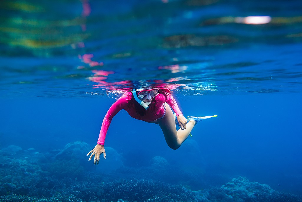 Snorkeling in the crystal-clear waters around Manuel Antonio.