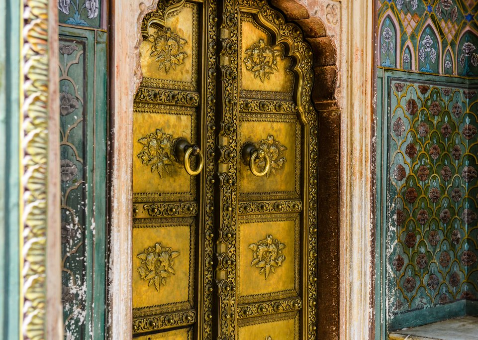 The beautiful detailing on the Rose Gate in Jaipur City Palace