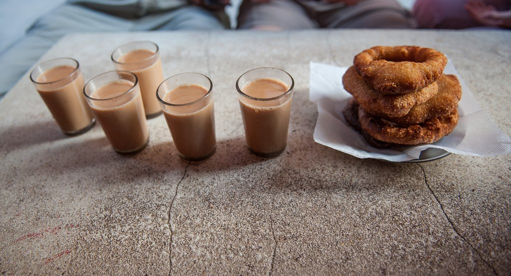 A traditional Nepali breakfast of milk tea and pastries