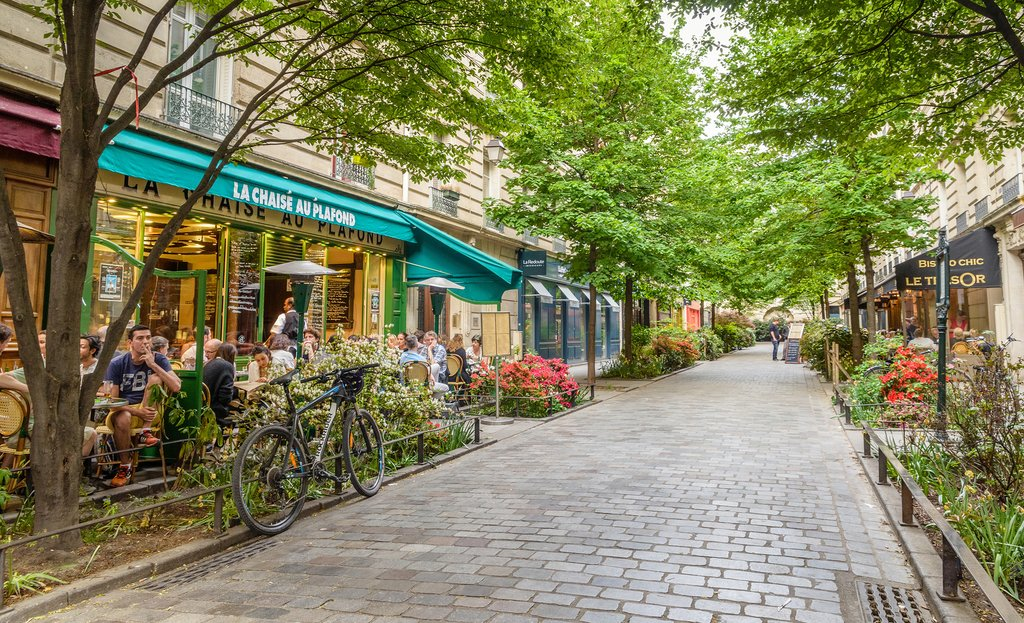A quiet street with restaurants in the bohemian Marais district