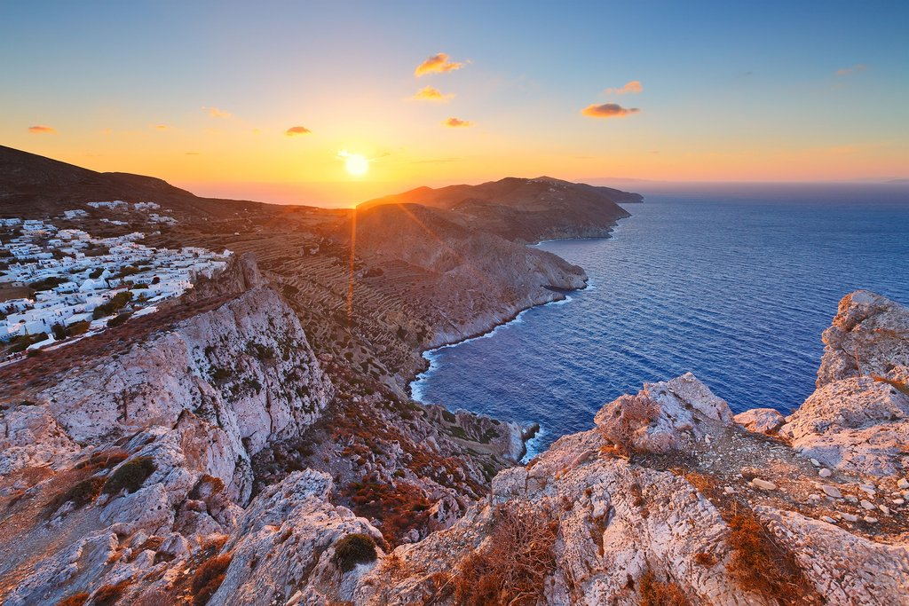 The island of Folegandros and its Chora seen at sunset