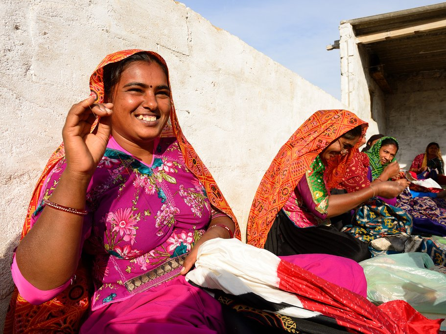 Women sewing traditional clothes in Bhuj