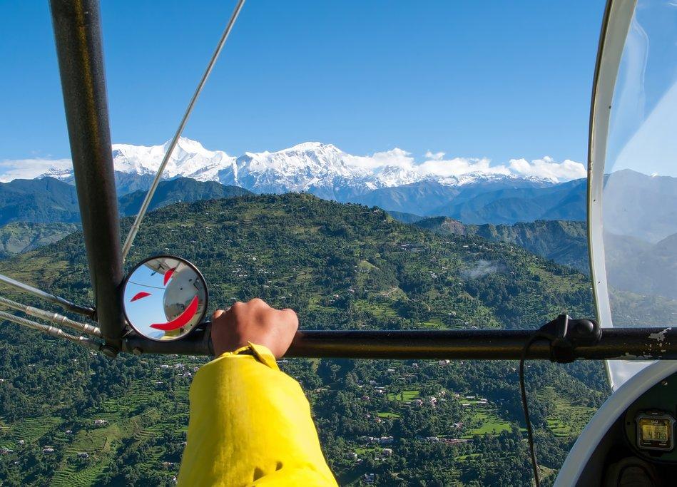 Pilot flying an ultralight in Pokhara
