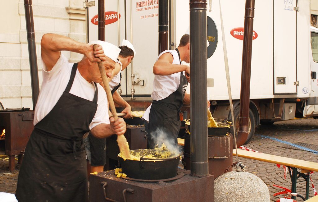 Chefs stirring polenta during the annual Friuli Doc celebration
