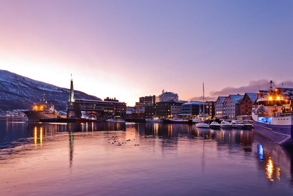 Tromsø's charming harbor at sunset