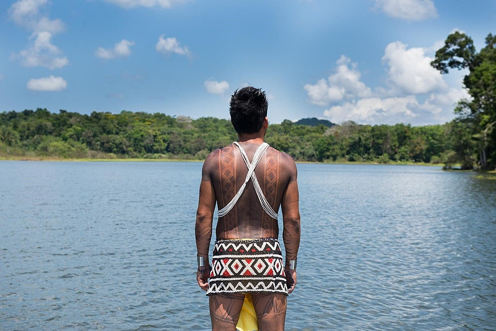 Embera in canoe