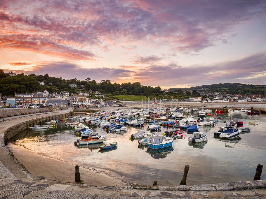 Sunset over Lyme Regis Harbor.