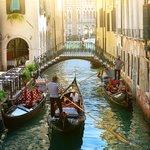 Small Canal in Venice and Gondolas