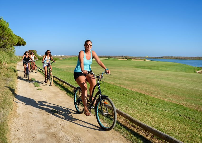 Ride past the lagoons and dunes of the Ria Formosa