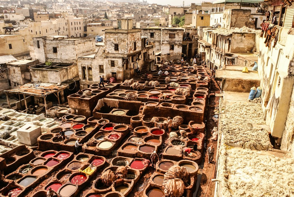 Stone pots filled with dye, cloth, and leather hides, Chouara Tannery