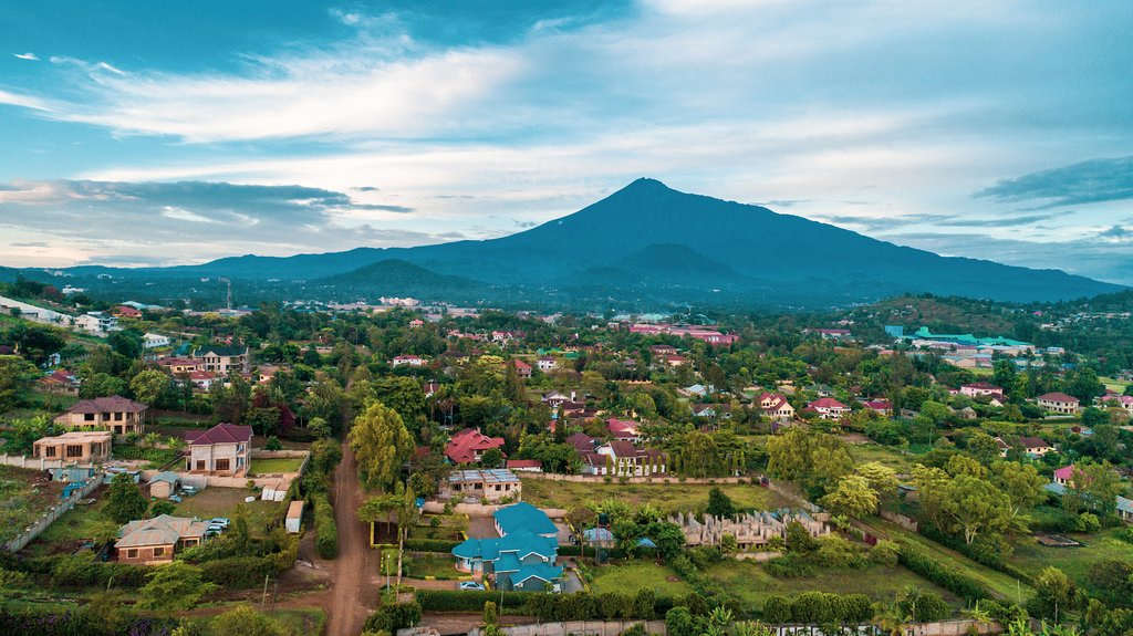 Arusha sits at the foot of Mount Meru