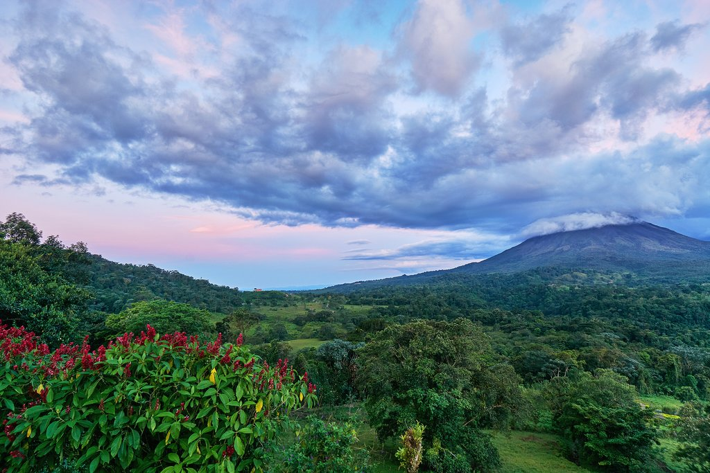 Arenal in the clouds at sunset