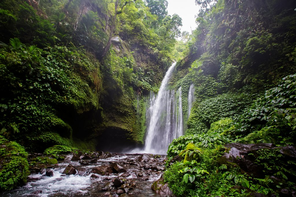 Take a short hike through the jungle to Sendang Gile waterfall