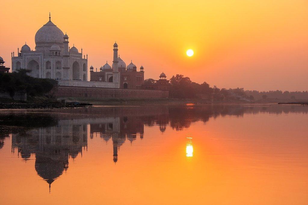 See the sun set over the Taj Mahal and the Yamuna River