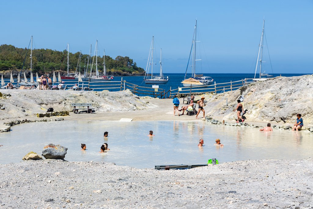 Italy - Sicly - Vulcano - People relax in a mud pool on Vulcano Island