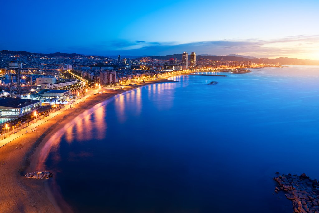 Take a sunset cruise around Barcelona