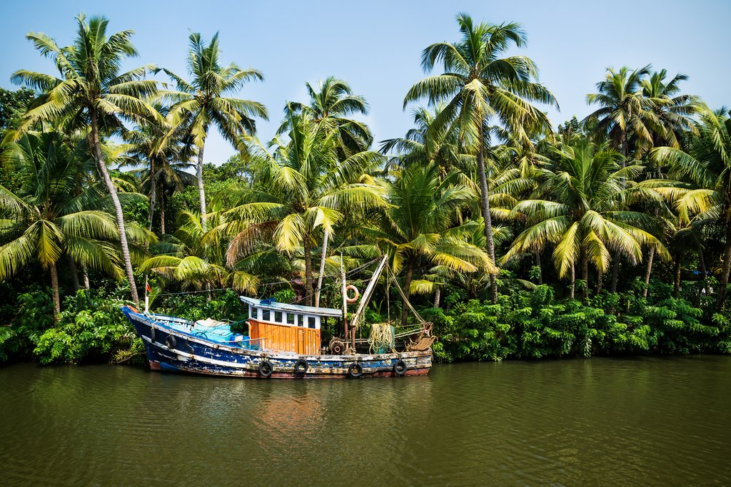 An old ocean fishing boat in the Kerala backwaters