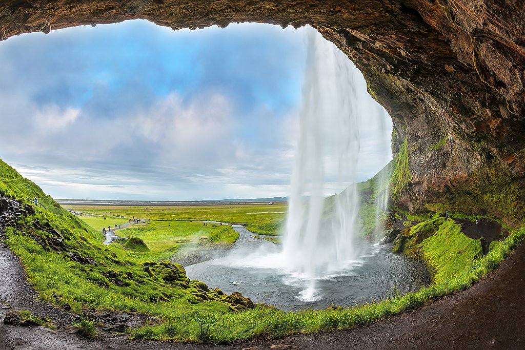 A view of Seljalandsfoss from behind the waterfall