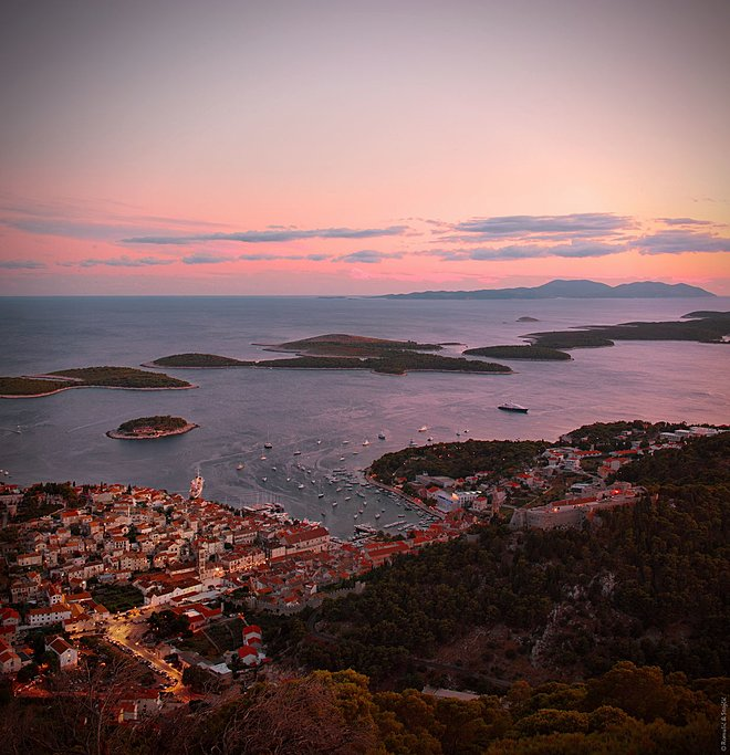 Watch the setting sun over the Adriatic