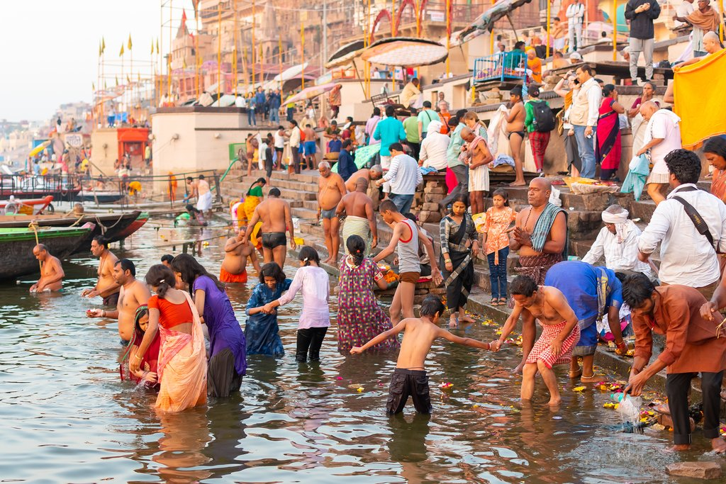 Watch the Hindu Pilgrims bathe in the holy waters of the Ganges