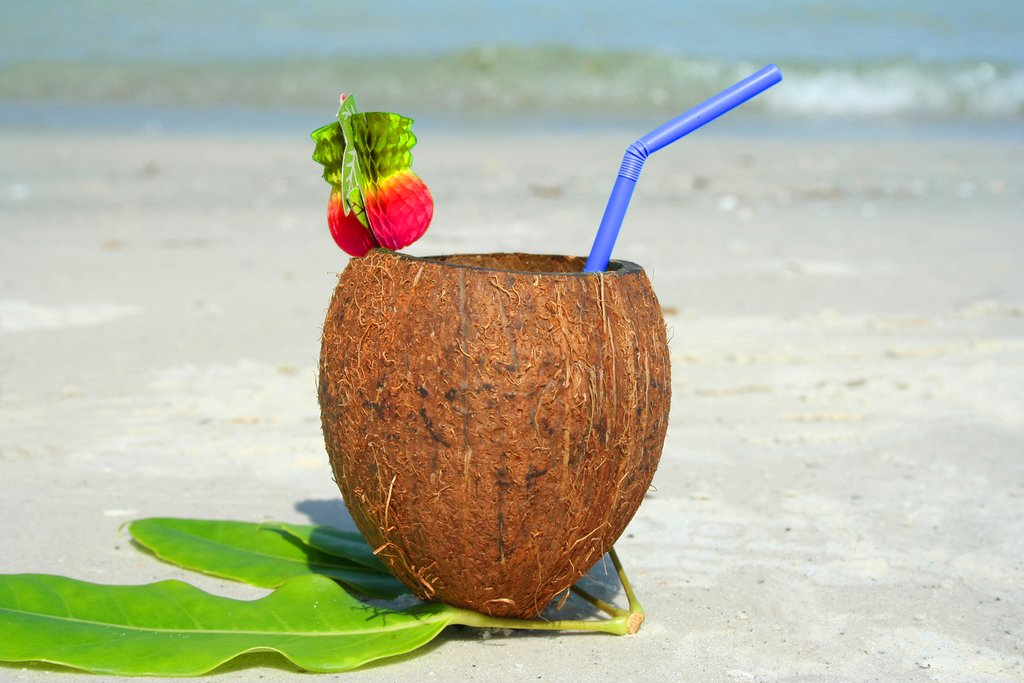 Enjoy a tropical drink on the beach