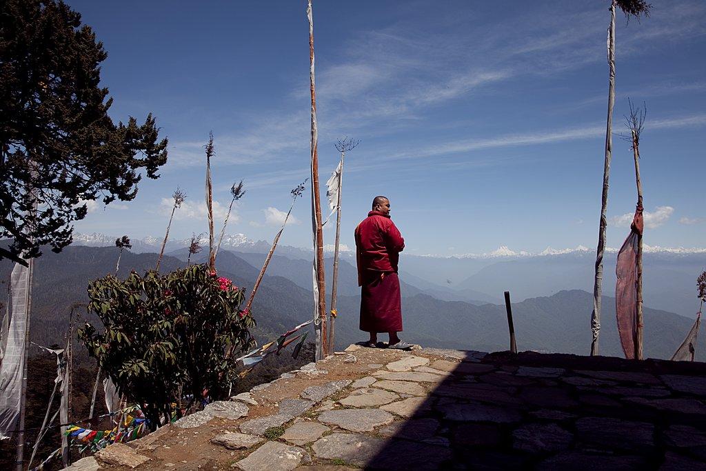 Monk enjoying the mountains