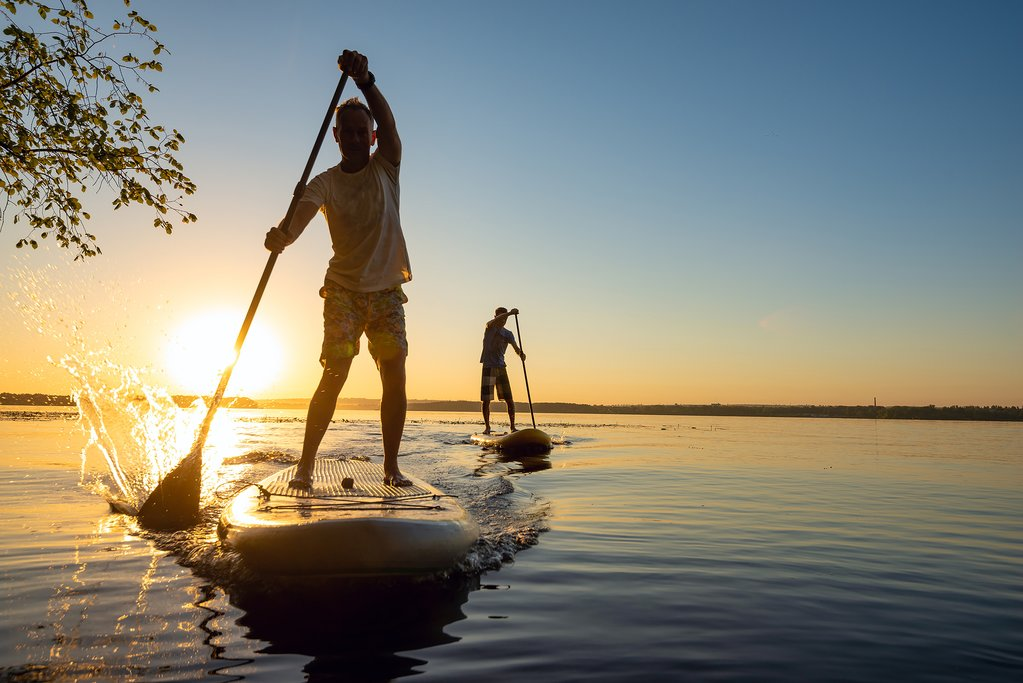 Try some stand-up paddle boarding