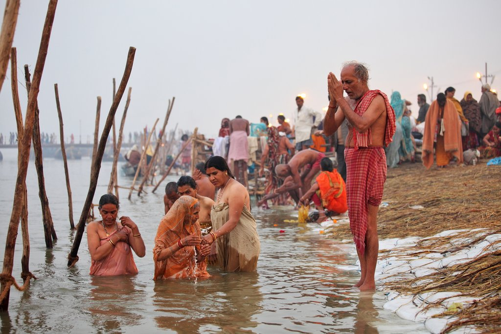 Hindu Pilgrims bathing in the confluence of the three holy rivers