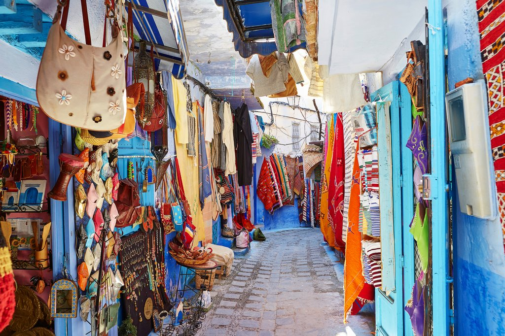 Shops line the narrow streets in Chefchaouen