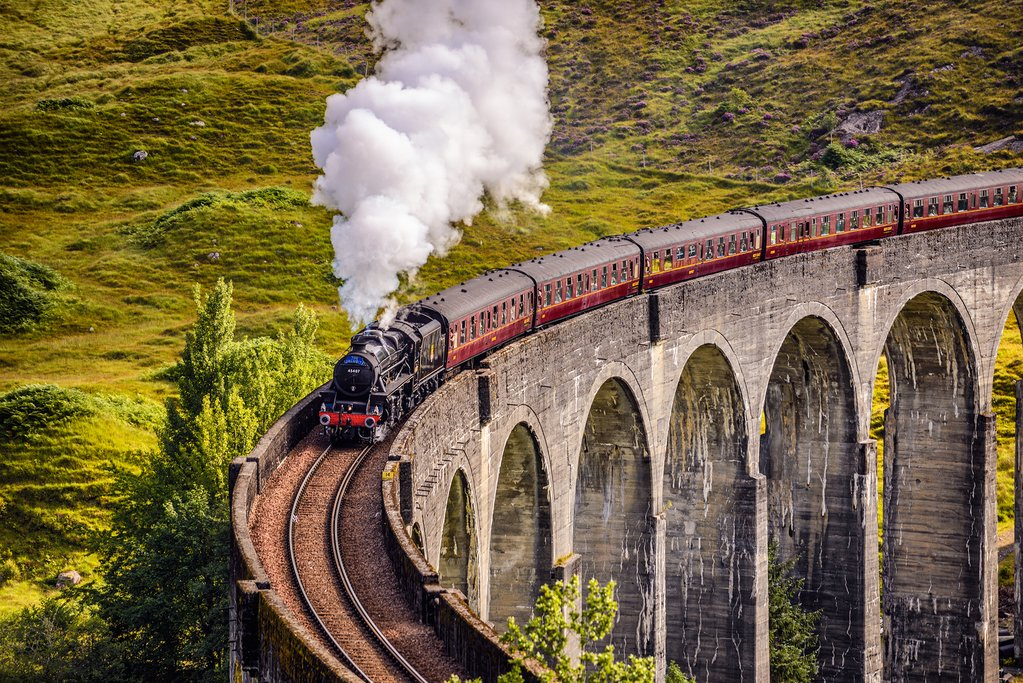 The Jacobite Express crosses the Glenfinnan Viaduct on its way to the coast.
