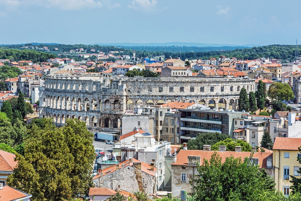 Roman ampitheater ruins blend in with modern Pula