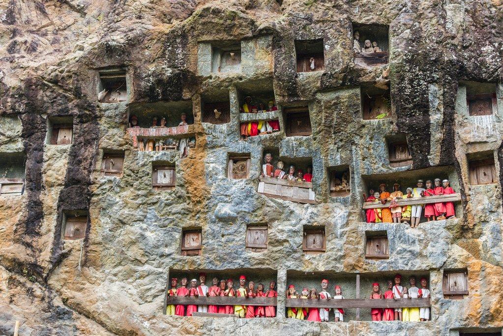 Visit Torajan cliff burial sites with Tau Tau wooden effigies