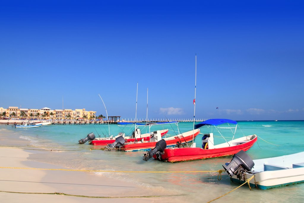 Boats on the shore in Playa del Carmen